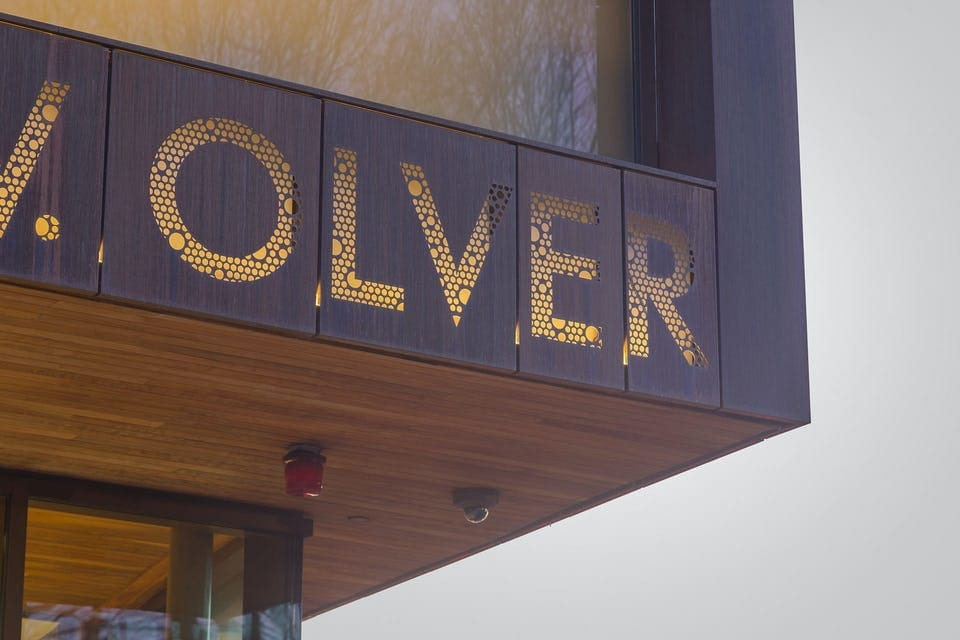 CUSTOM PERFORATED SIGNAGE FOR JOHN OLVER TRANSIT CENTER