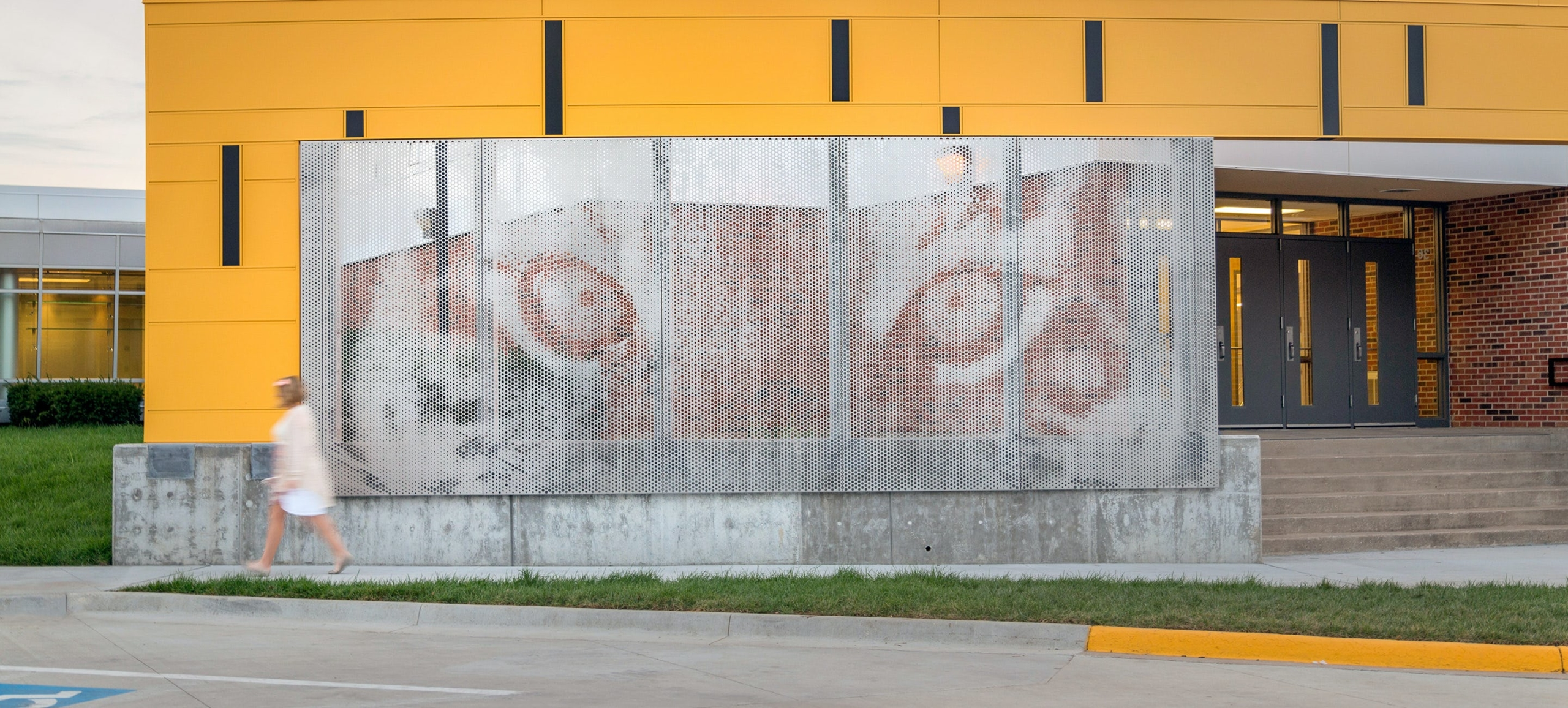 Custom perforated imagery made with ImageWall app by Zahner.
