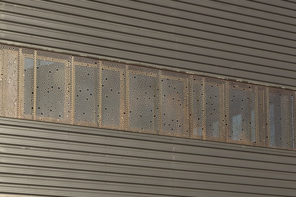 CUSTOM PERFORATED WINDOW SCREENS FOR JOHN OLVER TRANSIT CENTER.