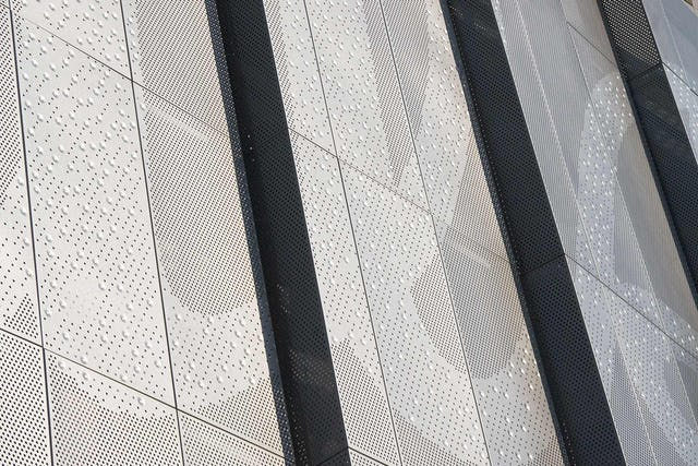 Perforated and bumped stainless steel, Kauffman Stadium.