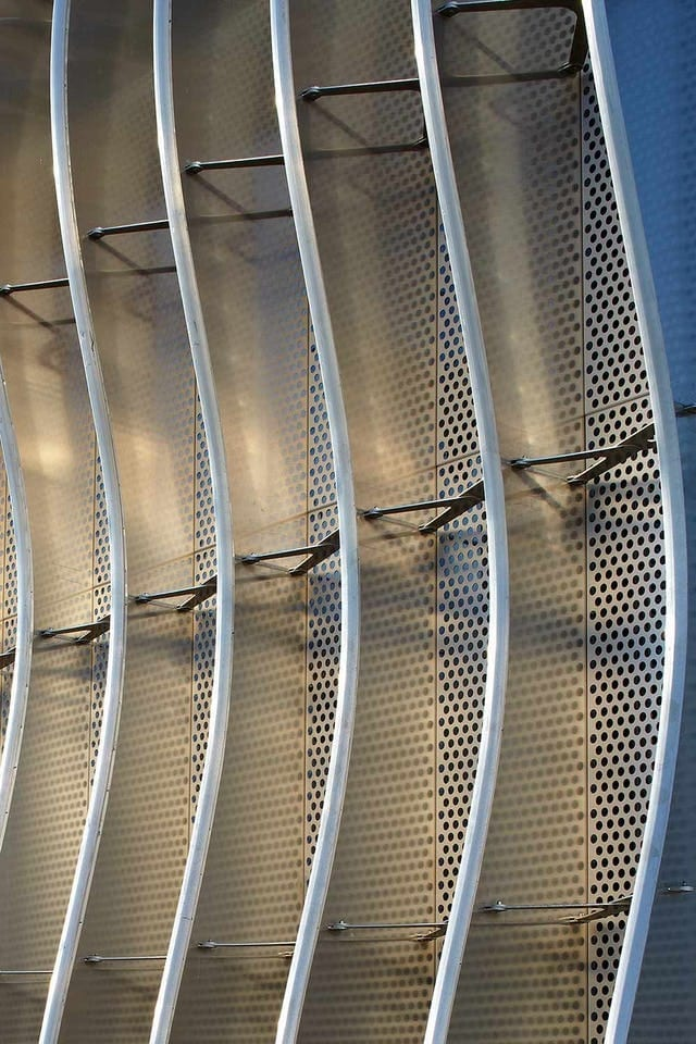 Perforated metal infill between CloudWall fins.