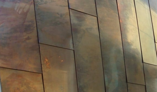 Detail of the custom patina on copper panels for the Waipolu Gallery