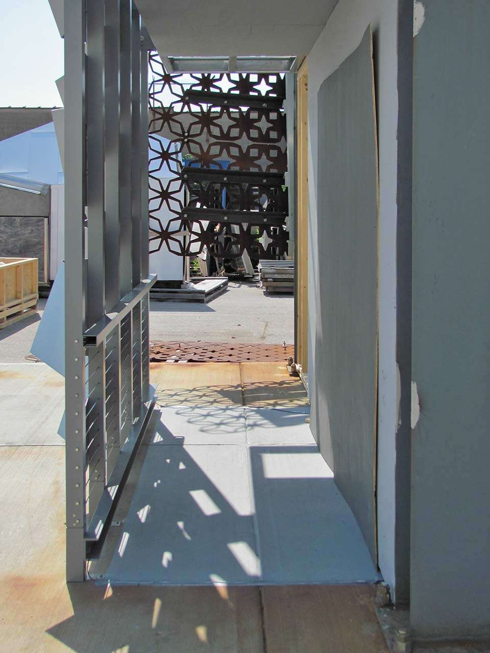 Photographs of the mockup, revealing the corridor which cuts through the facade.