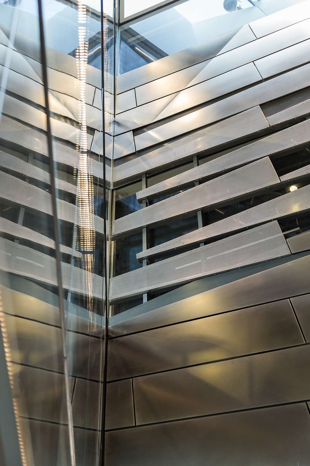 Detail of the shaded perforated metal panel system at Cornell's Science Center.