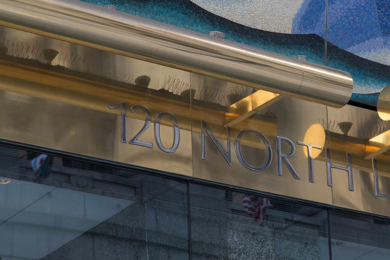 Muntz Metal signage at the entrance of 120 North LaSalle