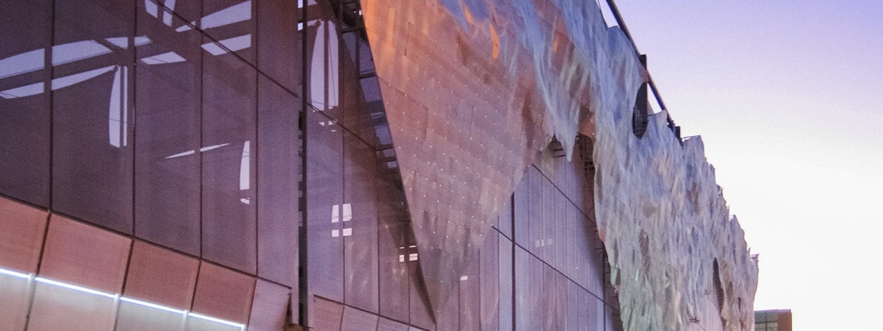 Dusk photograph of the Winds of Aphrodite artwork on Bartle Hall Loading Dock.