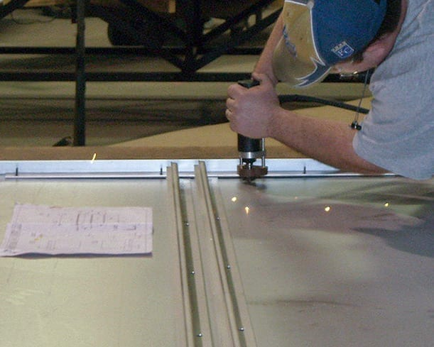 Zahner fabricator installs studs on the backs of NS11 Panels.