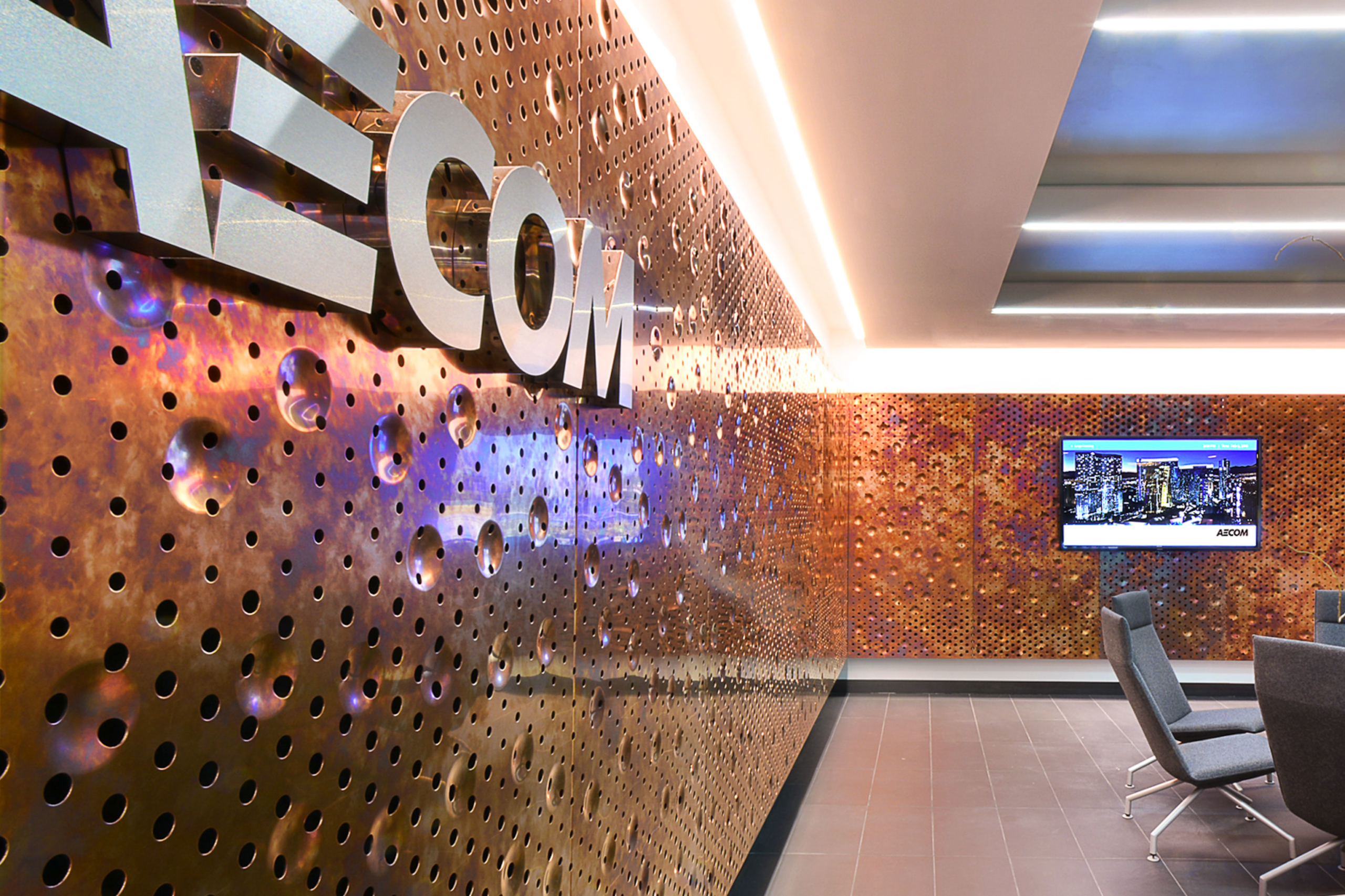 An ImageWall surface in the lobby of AECOM, featuring Zahner's Dirty Penny™ patinated copper.