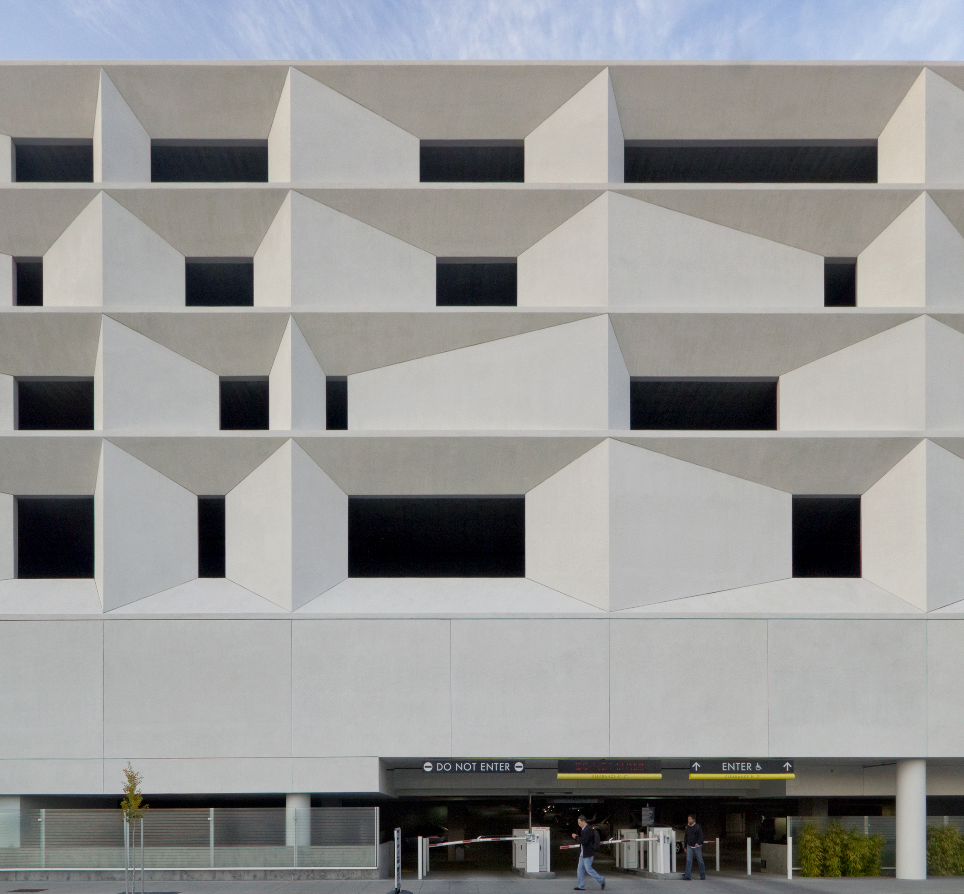 The northwest and south sides of the parking structure feature an intriguing stucco facade.