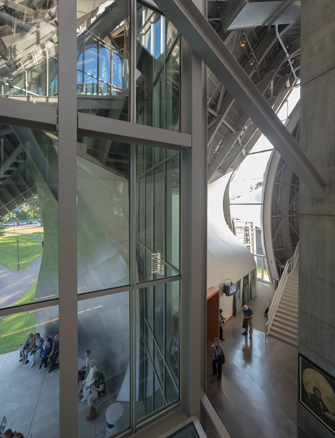 Interior and exterior of Fisher Center, viewed through the massive glazing system on the front entrance.