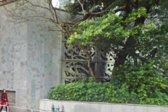 Ground-level art wall at the Carmen's Garden residences.