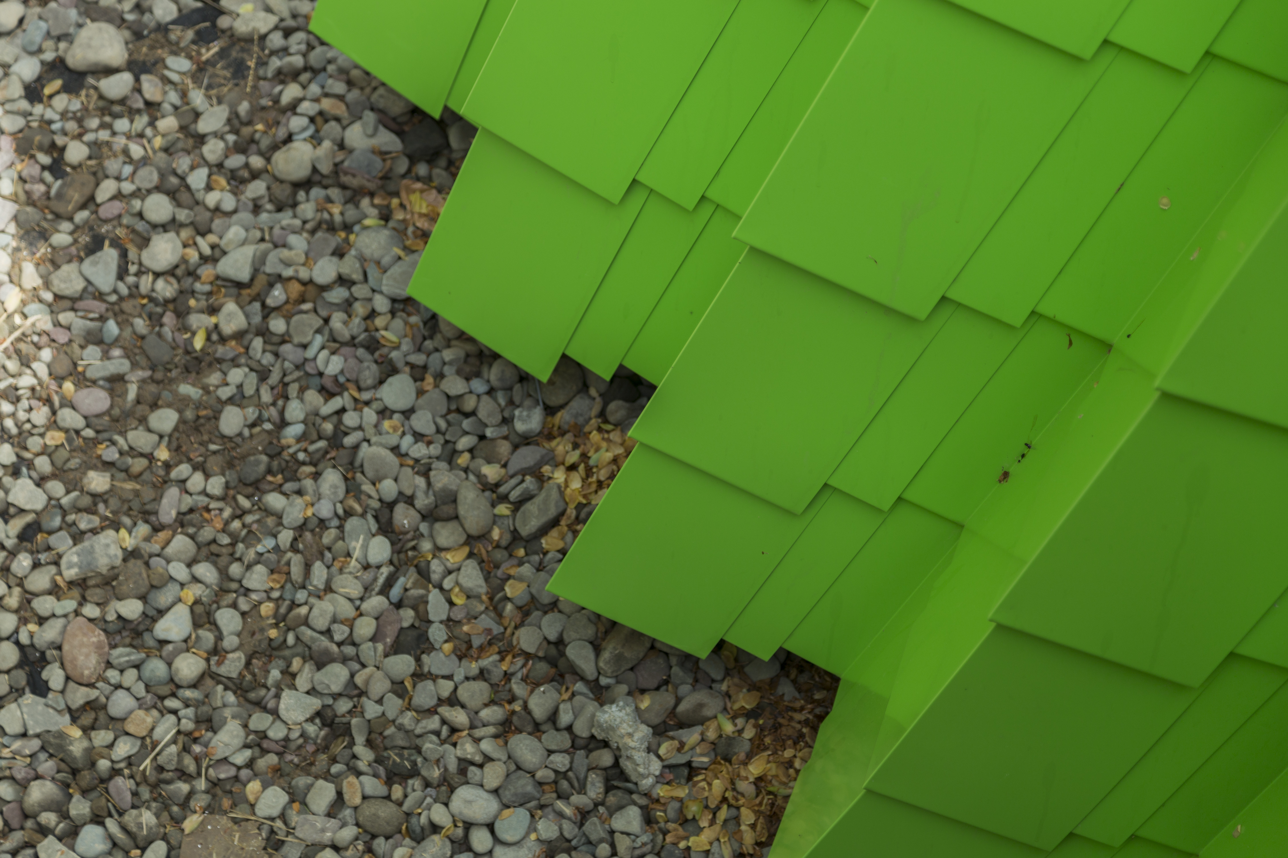 Detail of the painted aluminum shingles at grade.