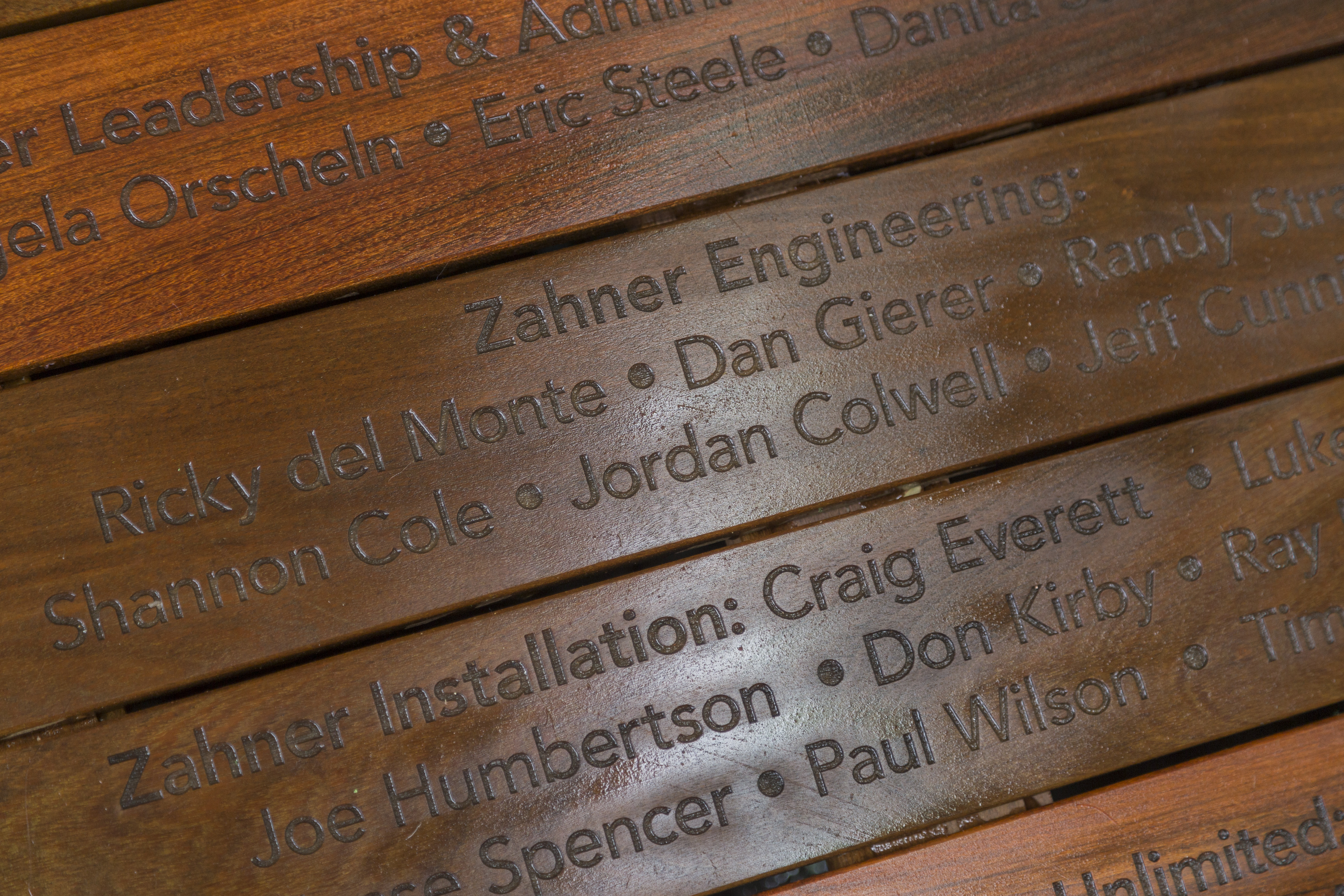 Engraved design and construction credits at The Chrysalis in Columbia, Maryland.