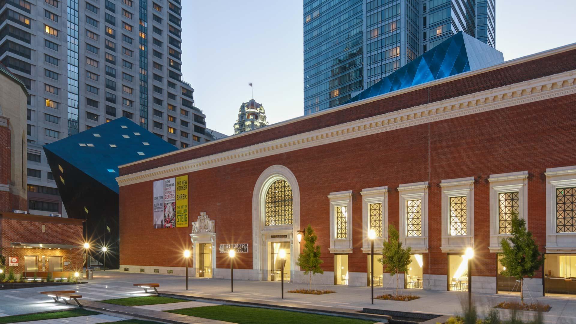 Evening photograph of the Studio Daniel Libeskind-designed Contemporary Jewish Museum .