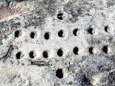 Islamabad cupules, Pakistan, 290,000-700,000 BCE.