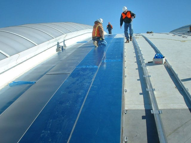 Zahner field installation crew during construction of the Inverted Seam roof system.