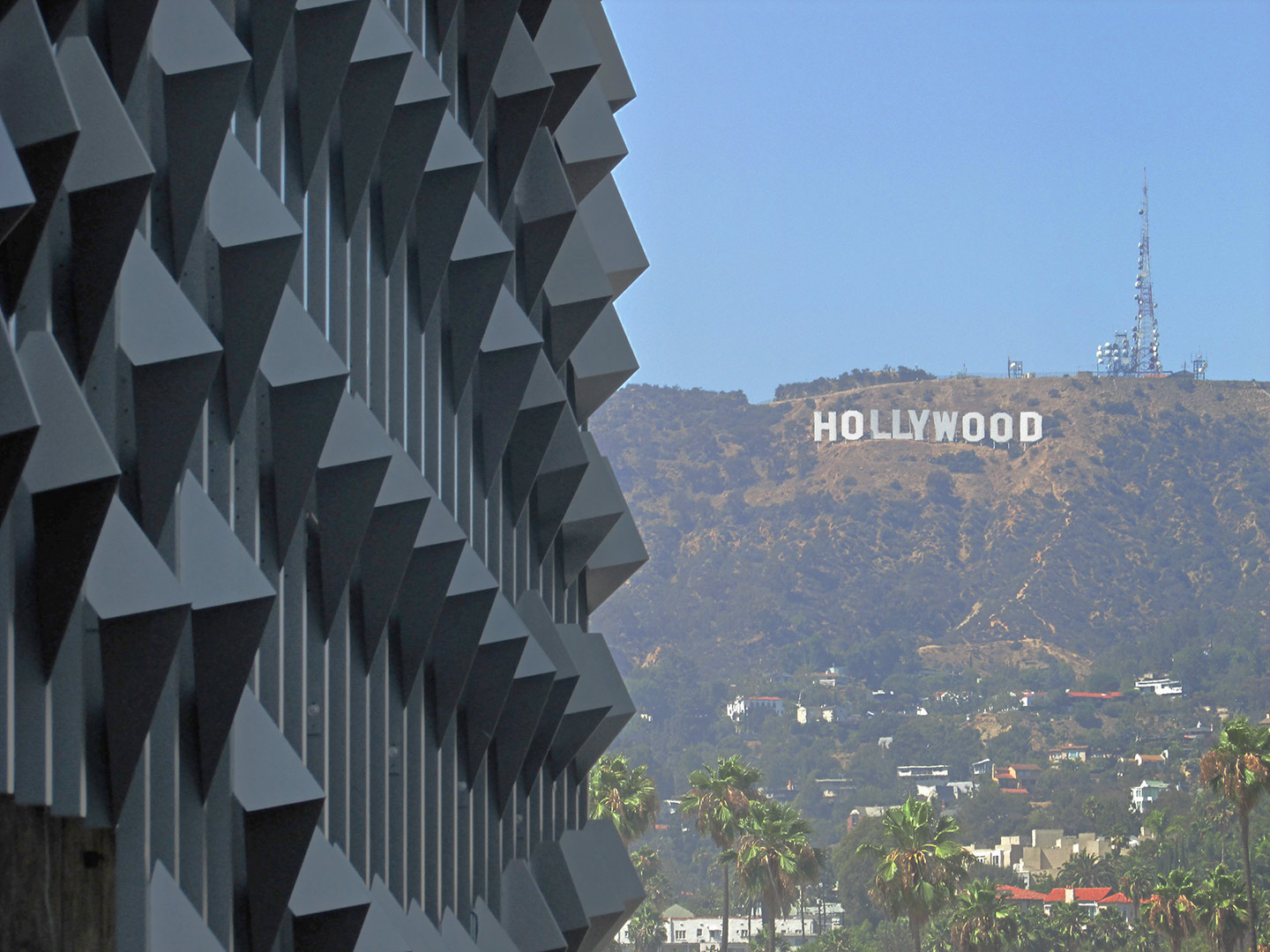 Detail of the Emerson LA facade against Hollywood Hills in California.