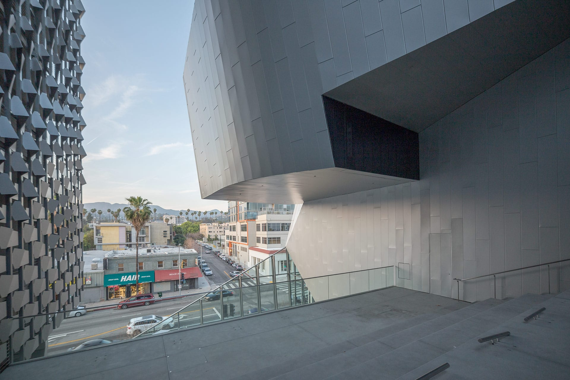 View of Sunset Blvd and Hollywood Hills through the piazza stairway at Emerson LA.