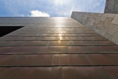 Upward view of the Freedom Center copper panels which have patinated to a dark red-brown.