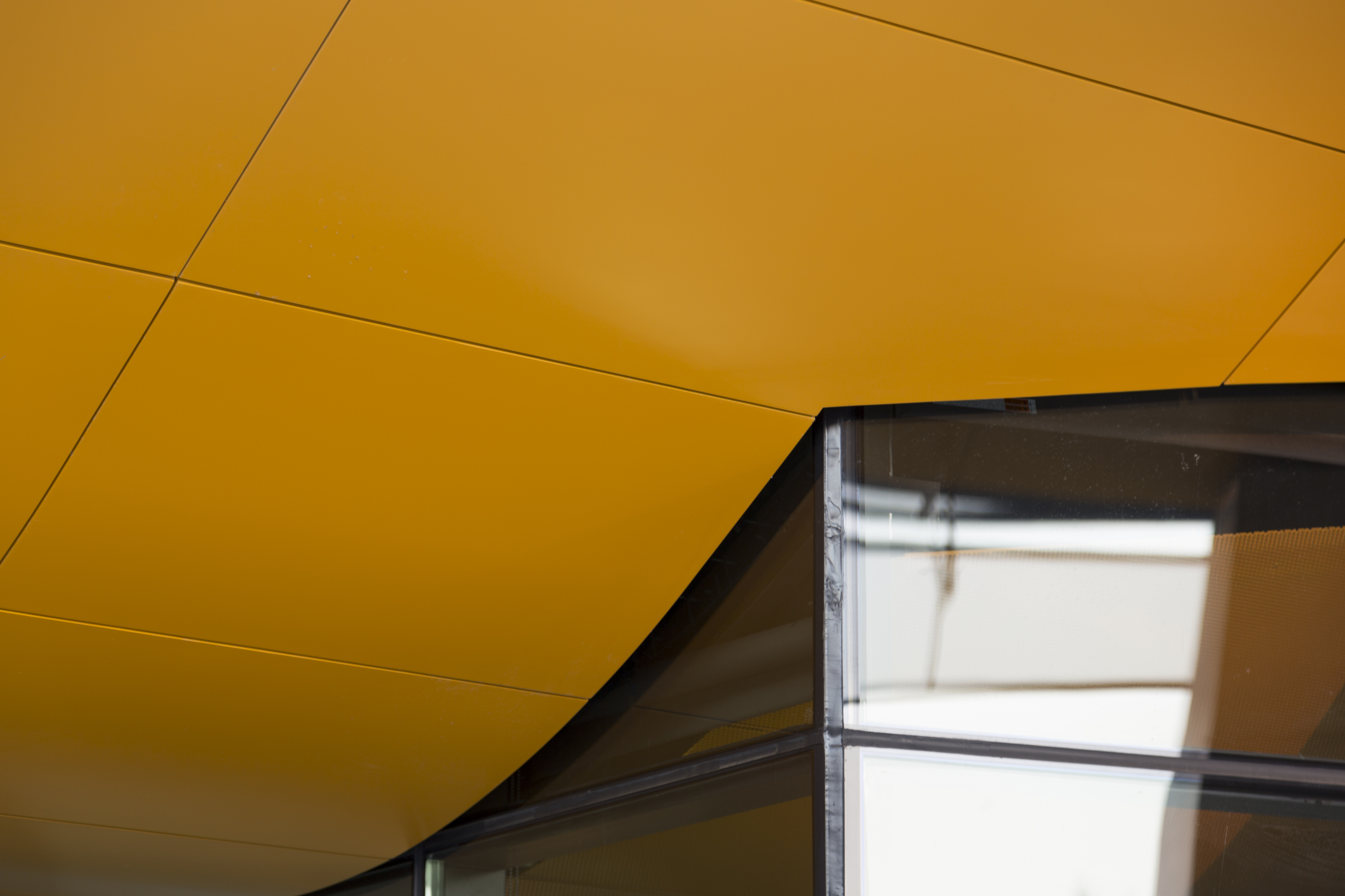 Detail of the orange-painted aluminum soffit system used on Gates Hall at Cornell University.