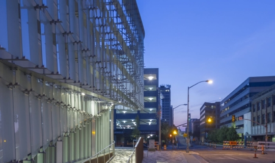 Night view of the glass lites on edge at the McCoy Federal Building.