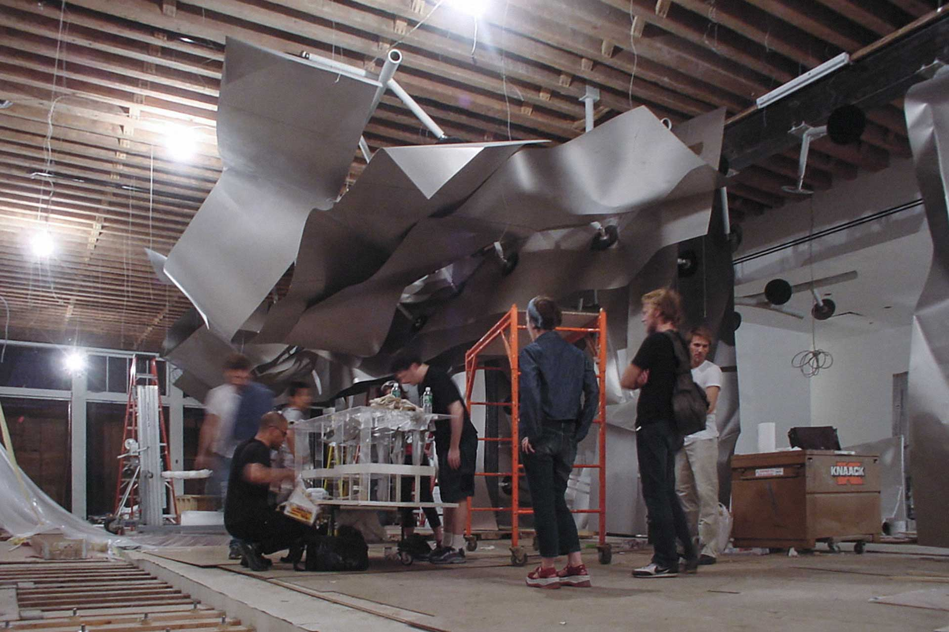 Installation process at Issey Miyake Tribeca.