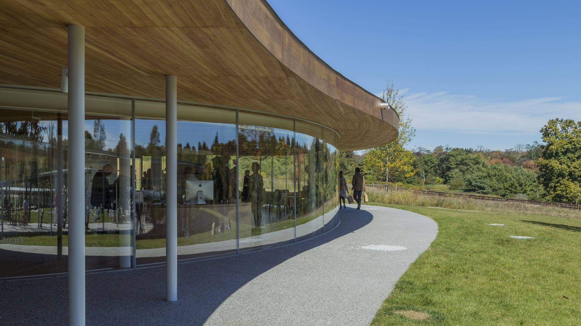 The building's wooden soffit provides a contrast to its reflective aluminum roof.