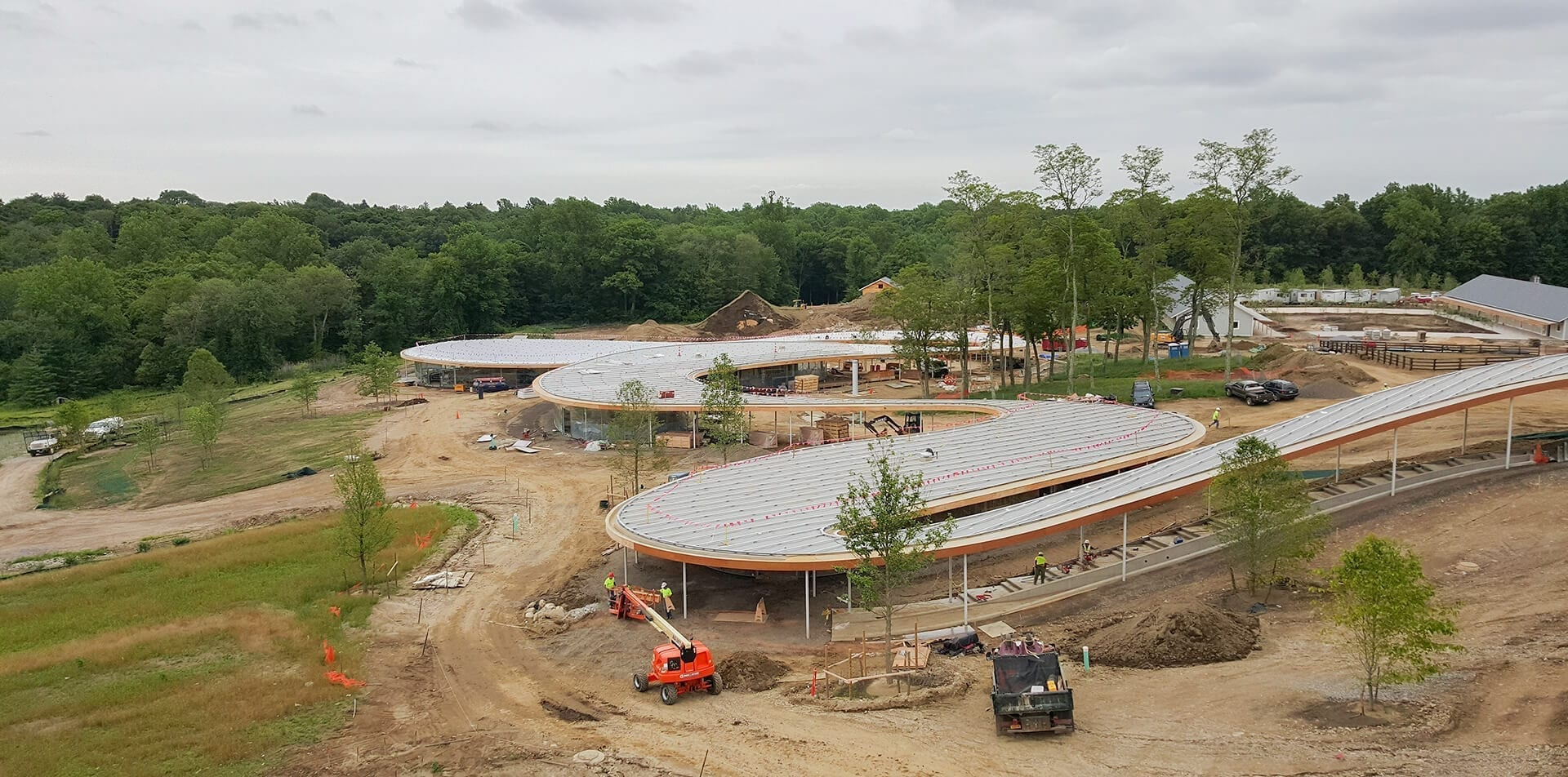 Installers lay the panels to create the dual curve roof on Grace Farms.