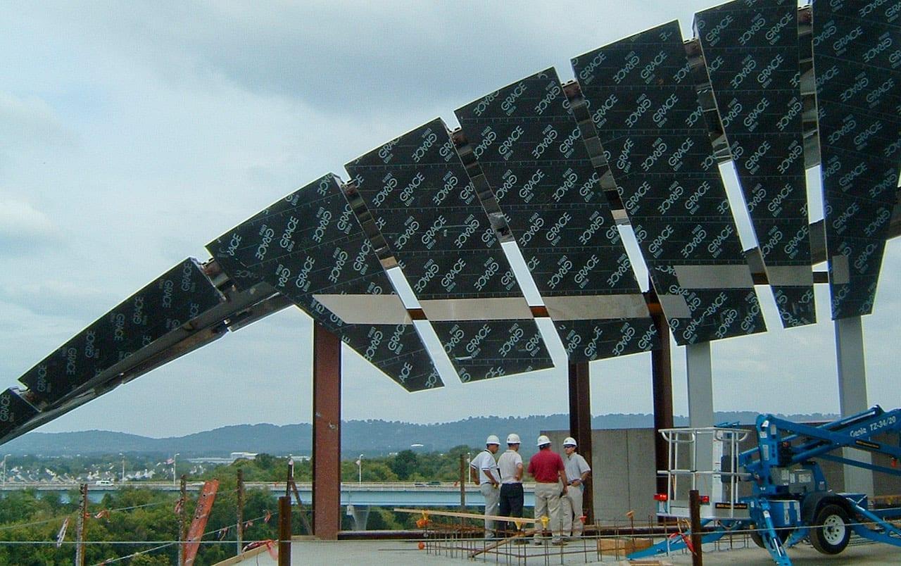 Contractors standing below several recently installed ZEPPS® Panels during construction.