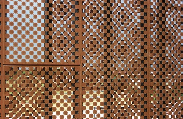 Moire patterns from overlapping perforated metal.