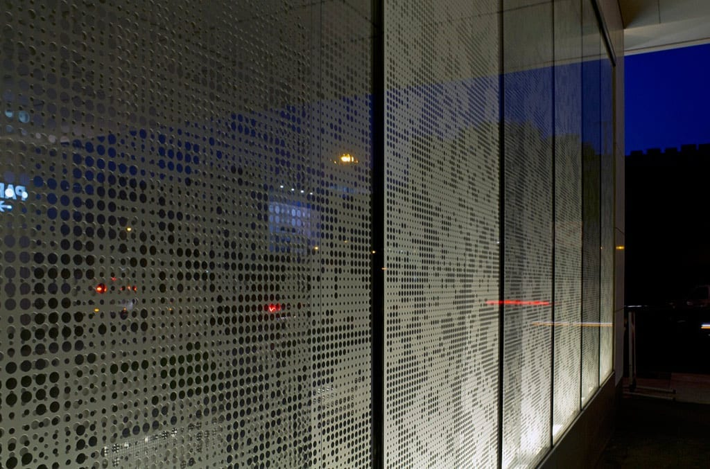 Silver Towers entrance at night.