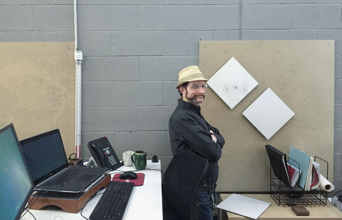 Jo Kamm at his workstation in the Zahner engineering facility.
