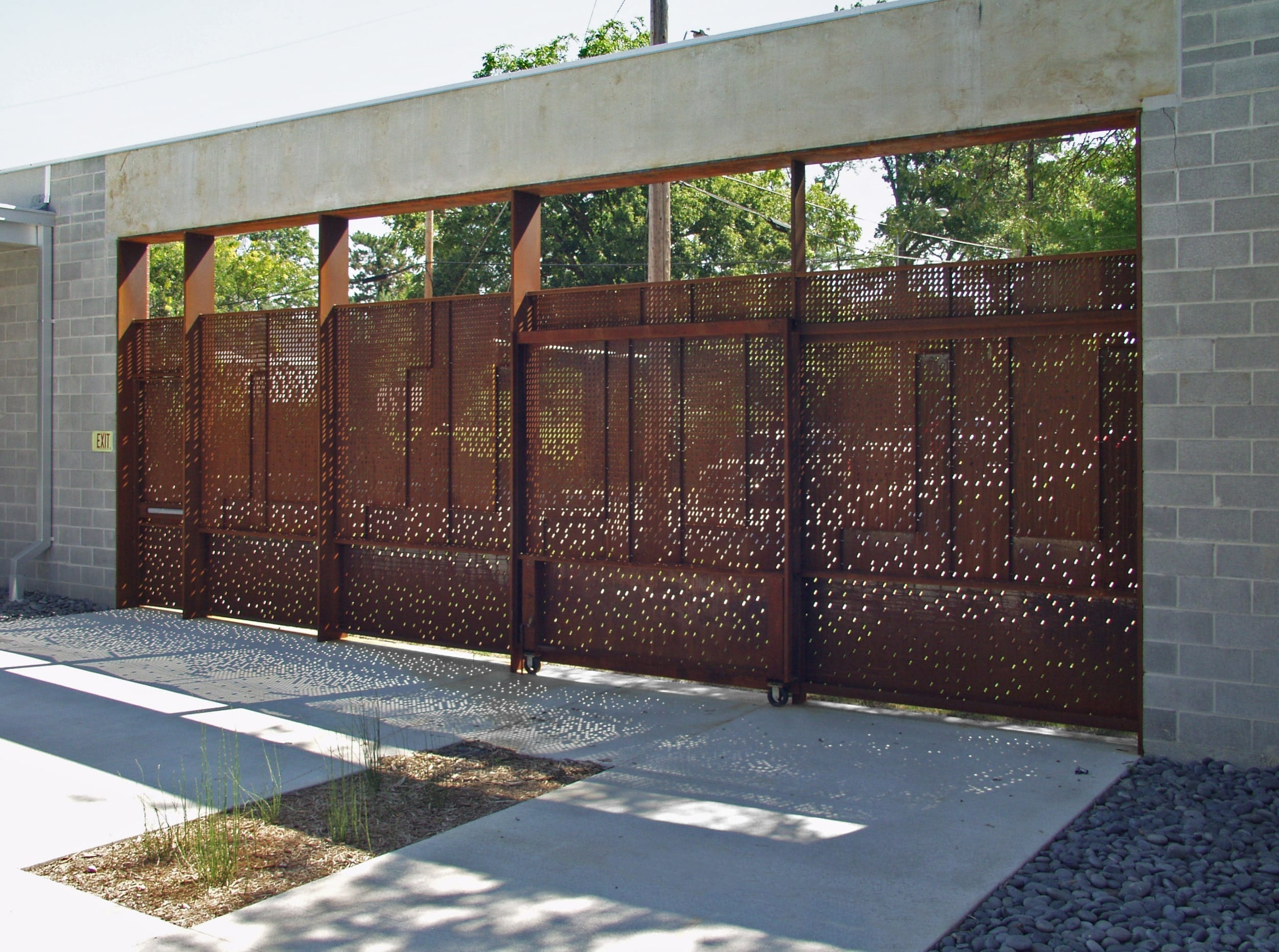 Light enters the space through the custom perforated steel for the Irving Courtyard screenwall at KCAI.