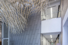 Interior space with custom zinc featurewall at KCPD Headquarters.