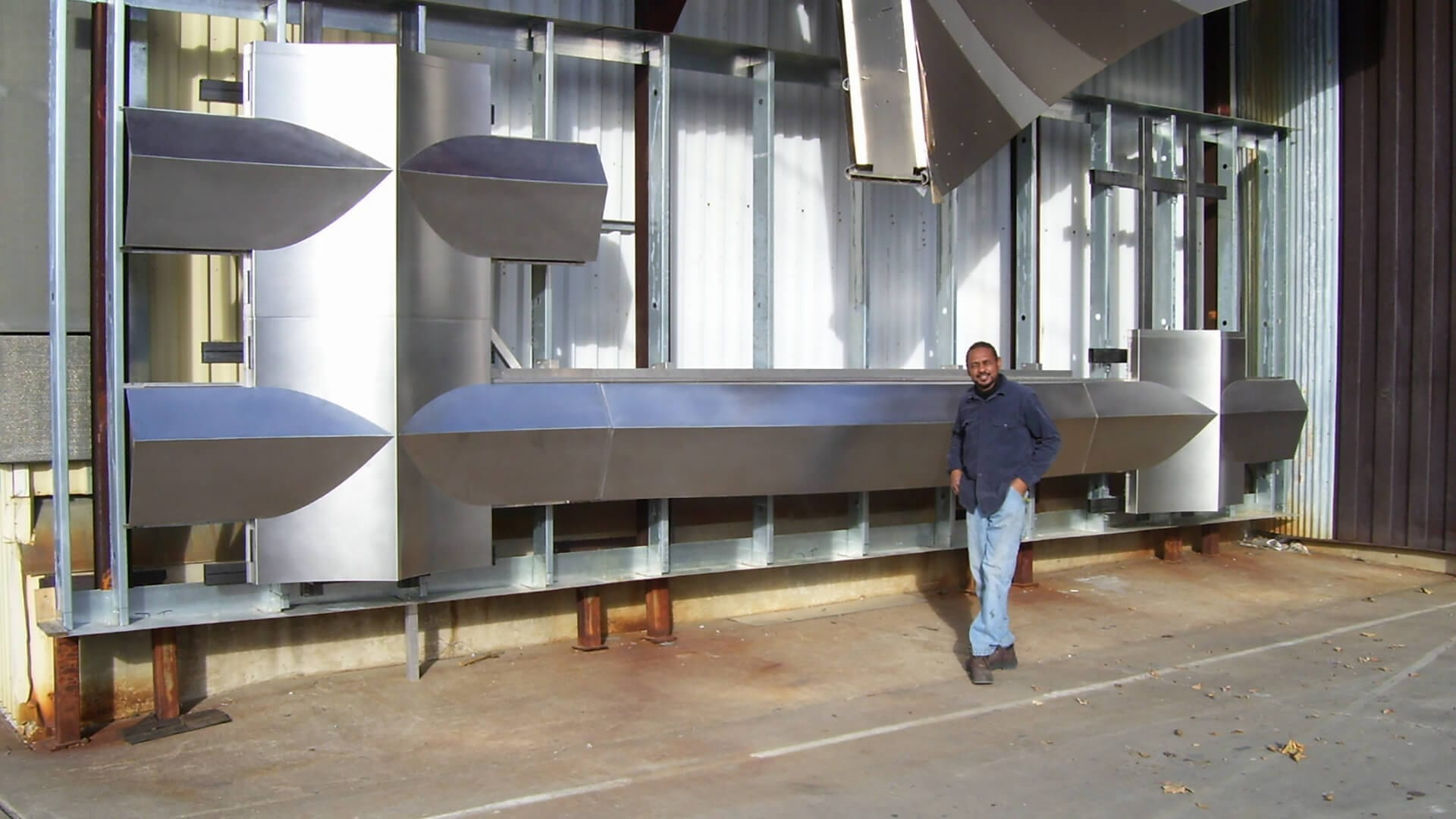 Zahner welder Kerry Butler with the 200 Eleventh mockup at the Kansas City factory.