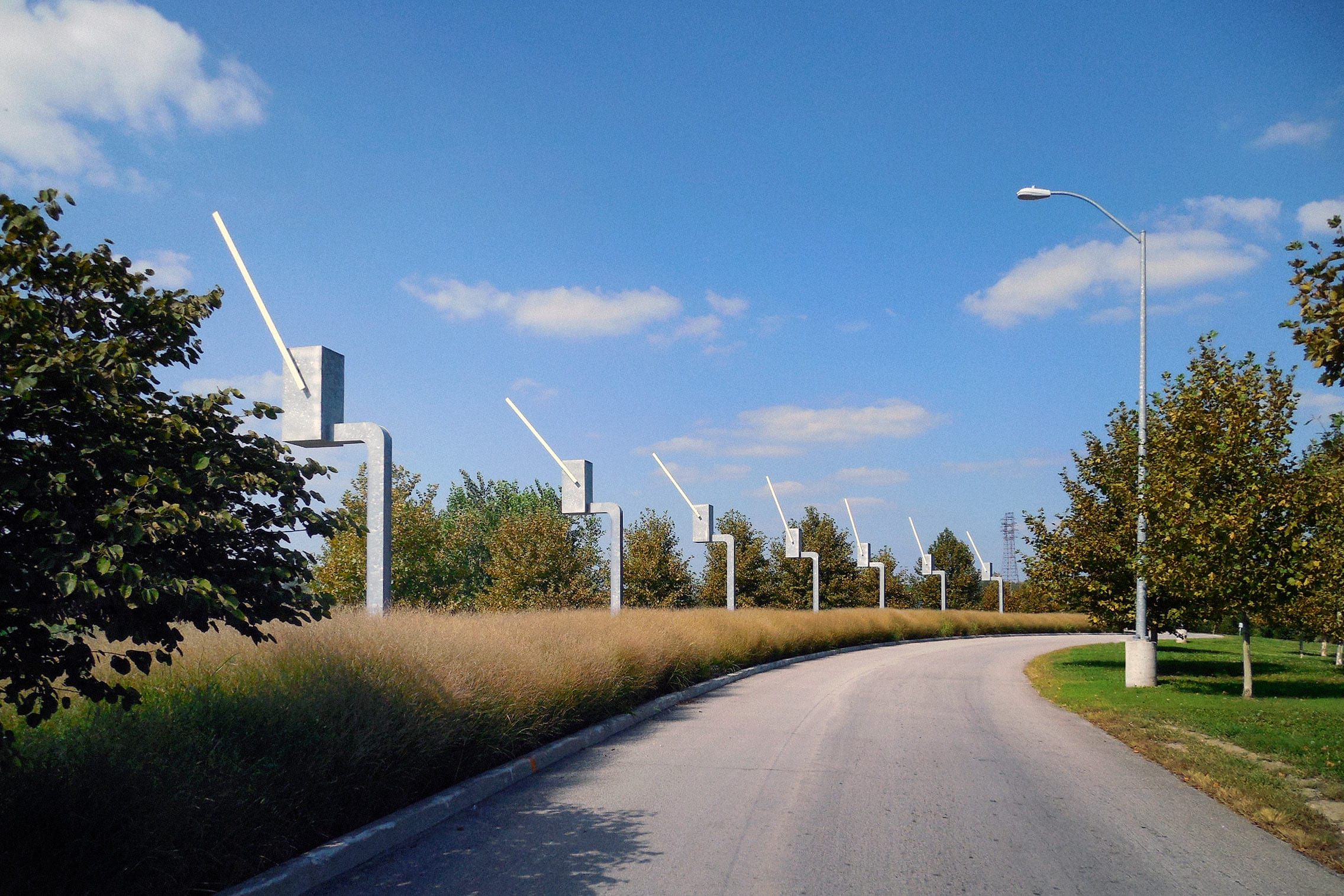Seven Sentinels kinetic sculpture made in galvanized steel. Each of the parking gate sculptures salute exiting drivers.
