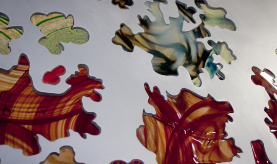 Detail of the inlaid glass on aluminum.