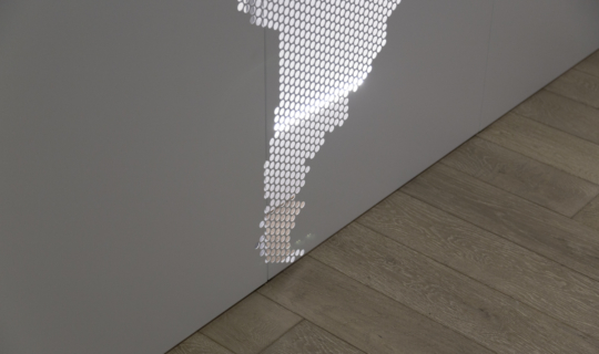 Detail of the Lineage Logistics interior perforated wall system