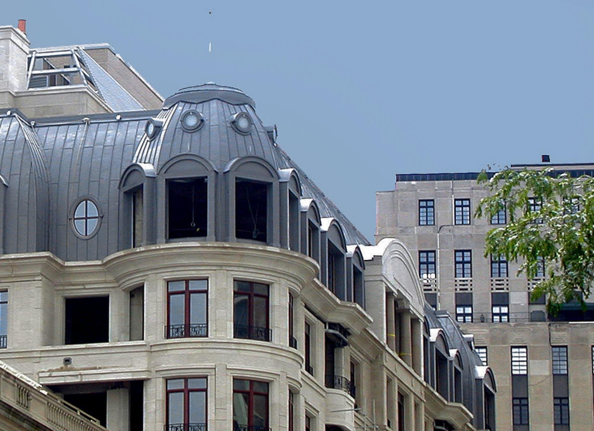 The Lucien Lagrange-designed 65 E. Goethe Building with Zinc Roof, an example of how traditions in architecture can benefit from modern scale fabrication and engineering technologies.