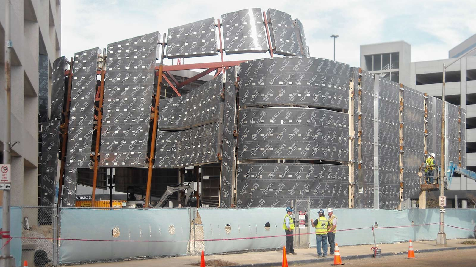 ZEPPS understructure visible as Zahner field operators prepare to install the lites of glass.