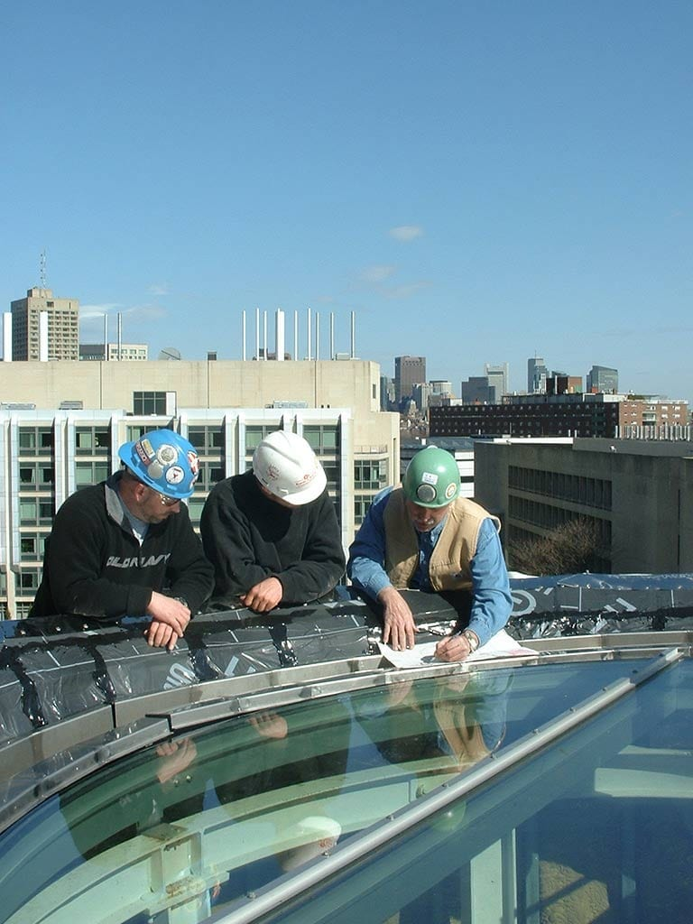 Facade installers in their office at MIT.