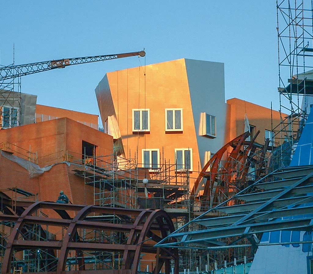 Sunrise glows over the Pisa building at MIT Stata Center during construction.