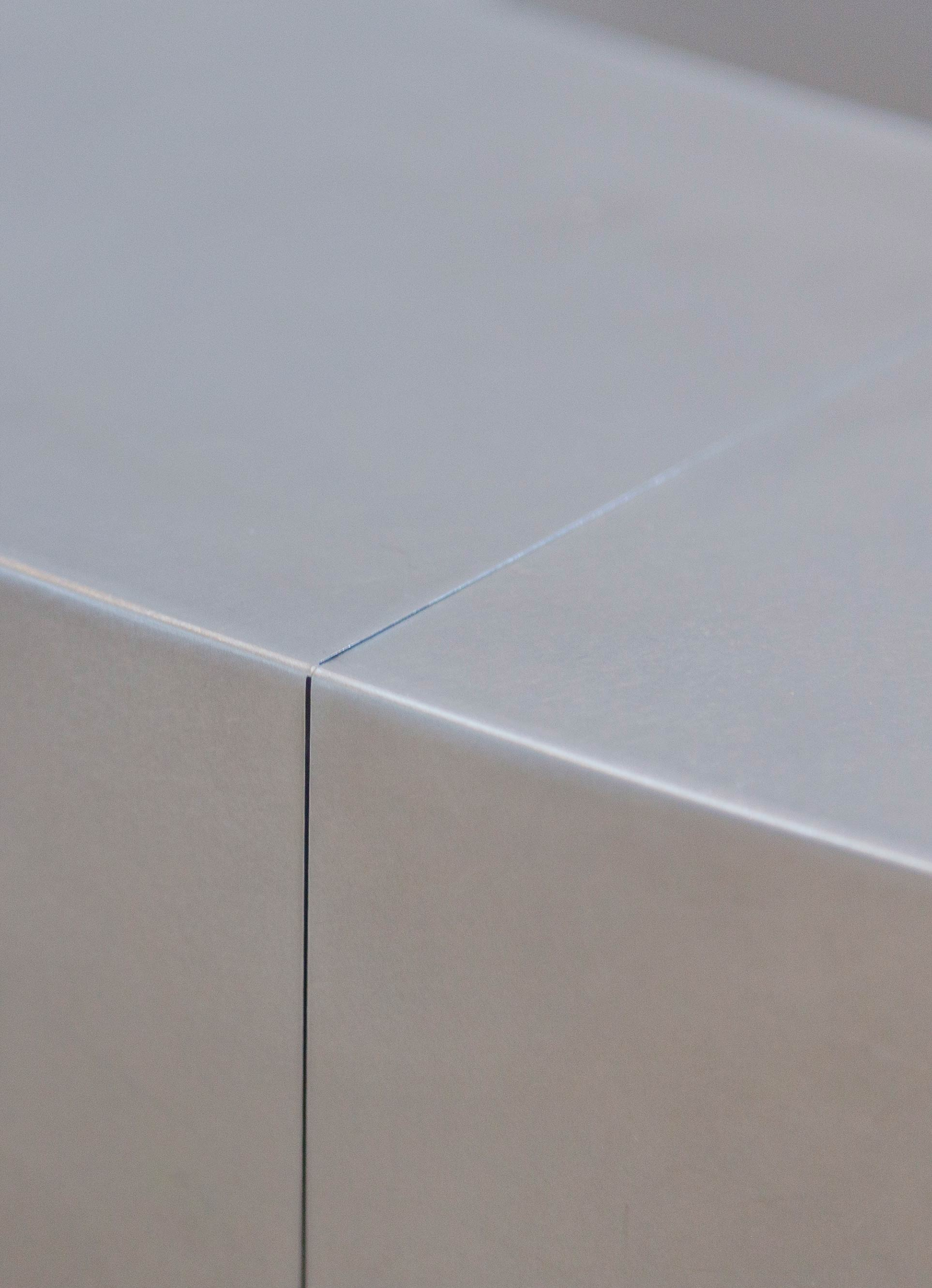 Detail of the stainless steel reception desk for the Nerman Museum of Contemporary Art