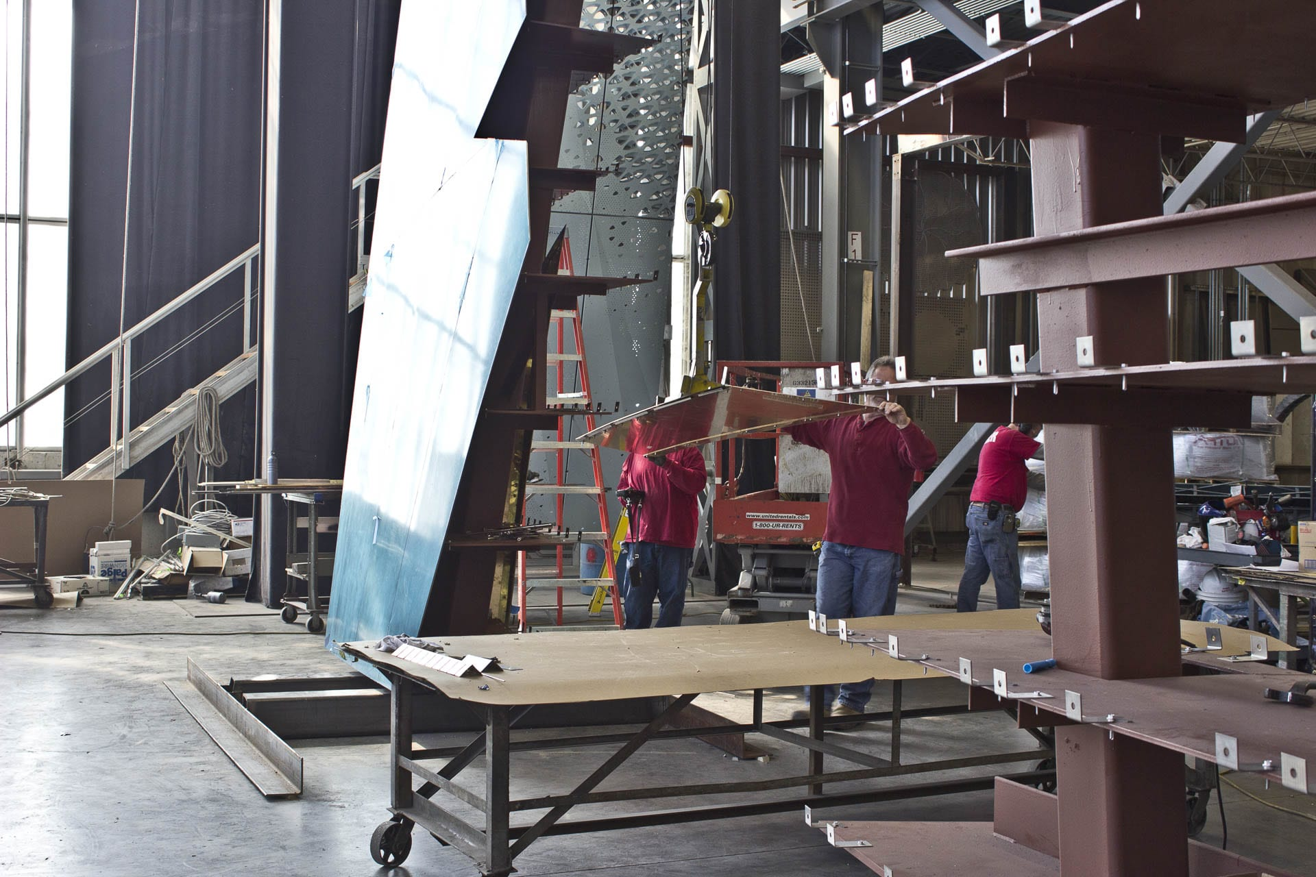 Fabricators at Zahner place panels on the Ohio Statehouse Holocaust Memorial
