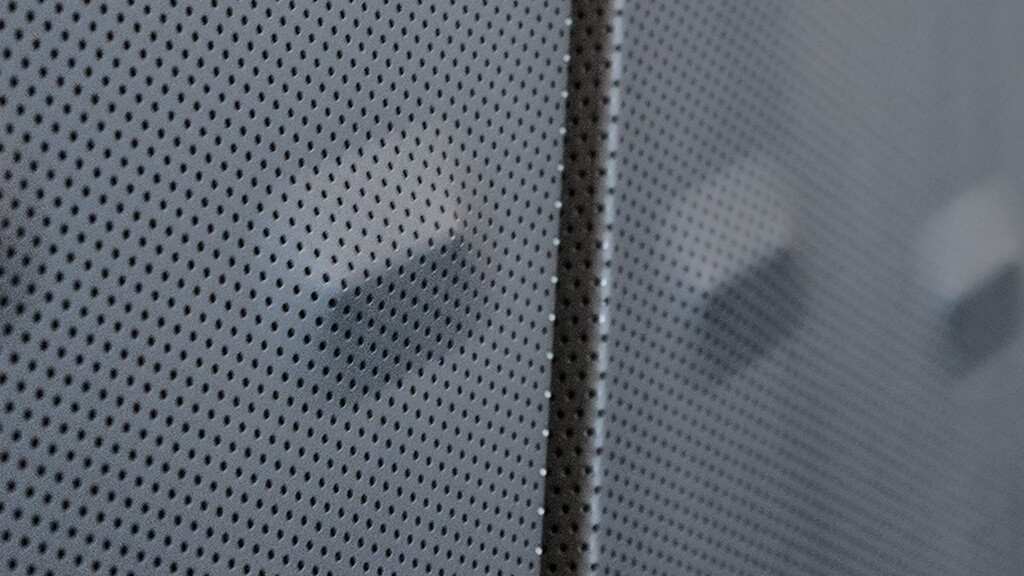 Detail of the perforated and bumped metal used on the new building.