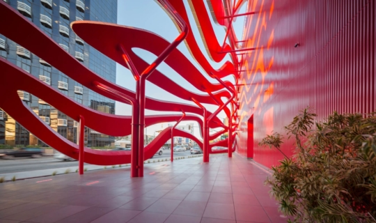 Underneath the undulating ribbon facade of the Petersen Automotive Museum.