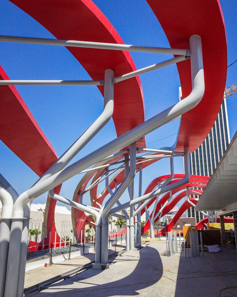 """Painted tubular steel """"trees"""" were designed by Zahner engineers to support the curving ribbons, on the building's roof and facade."""