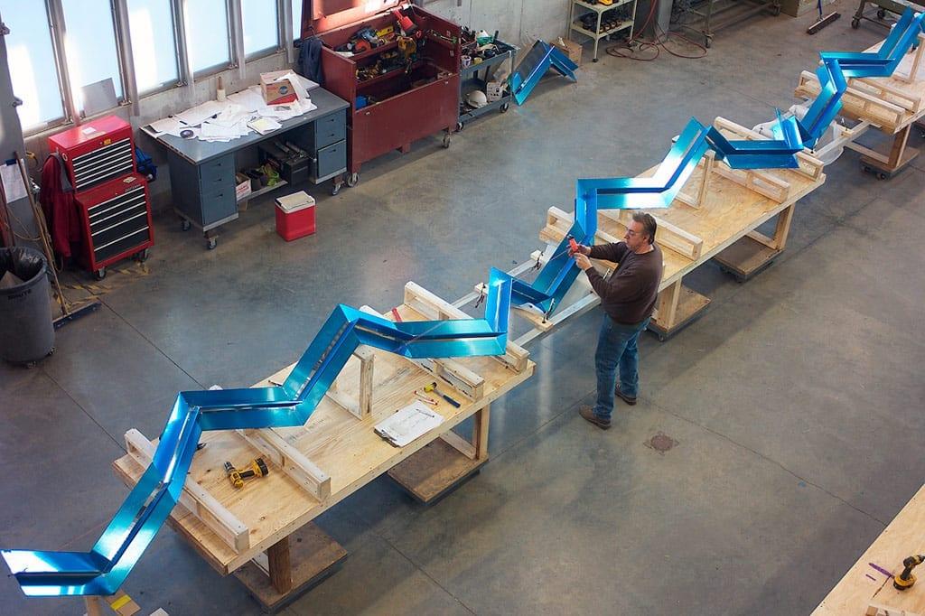 Zahner shop personnel make measurements to align the Regazzoni sculpture.
