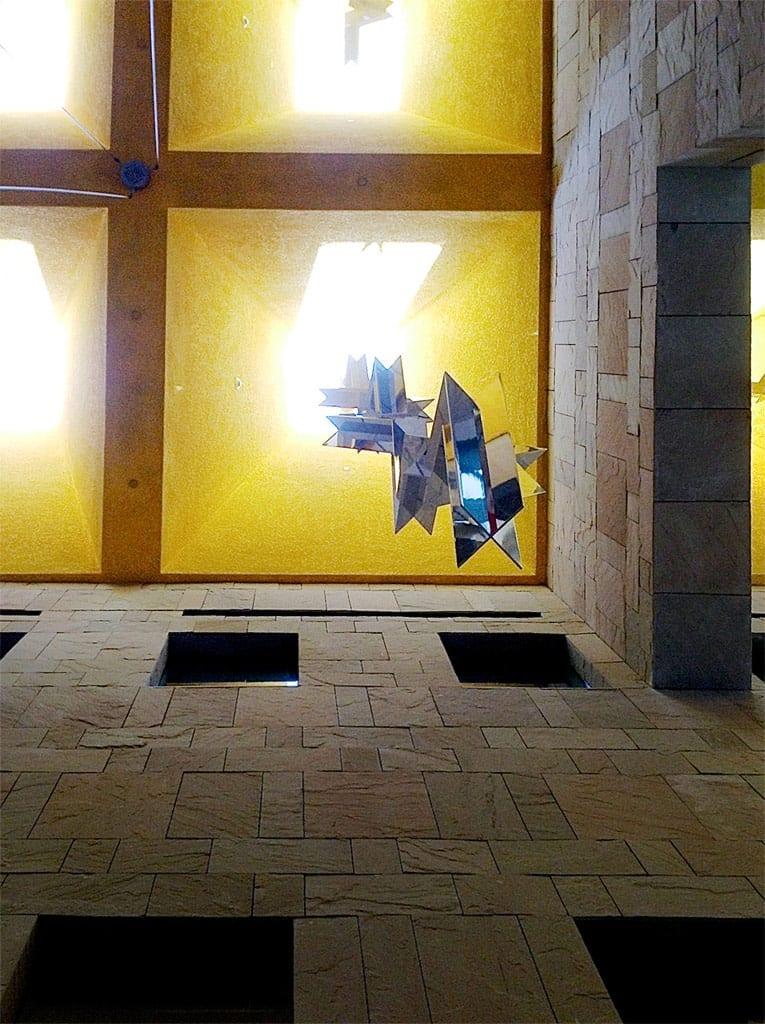 Upward view of individual hanging sculptures by Ricardo Regazzoni.