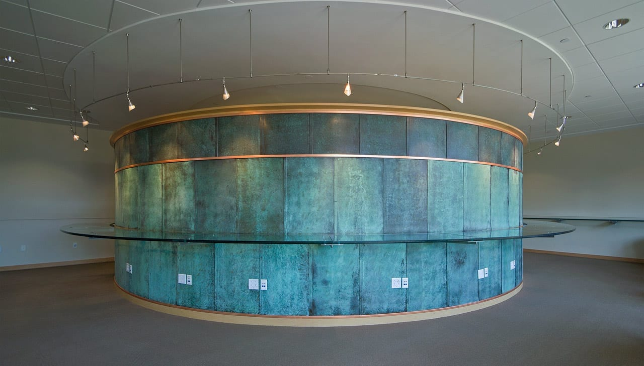 Custom copper patina on interior metal panels at the SMU Collins study room.